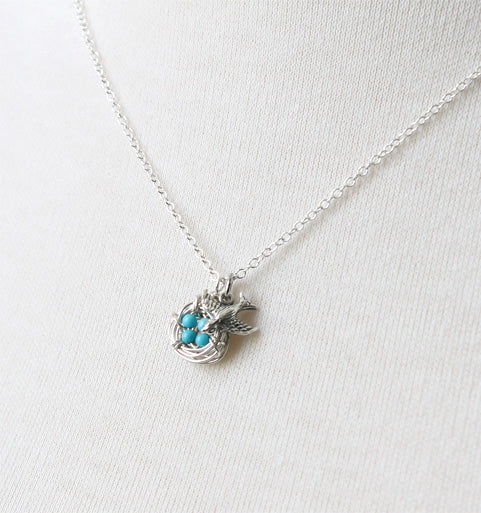 Silver bird nest necklace with turquoise eggs