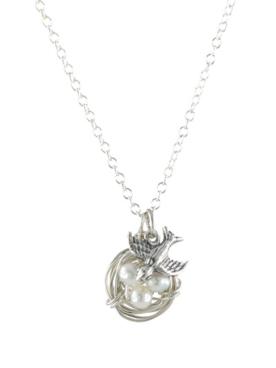 Bird Nest Necklace in sterling silver with pearl eggs