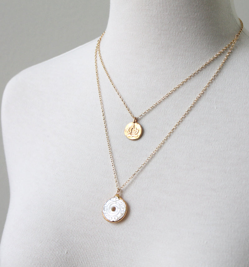 Double coin pendant by peggy li