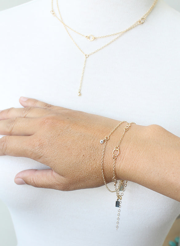 Delicate gold layering bracelets by Peggy Li Creations