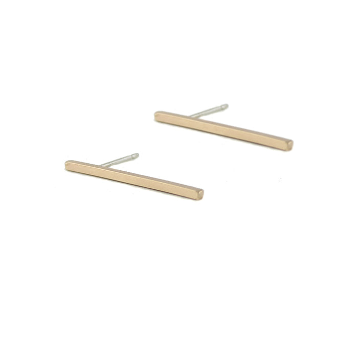 Long staple stud earrings