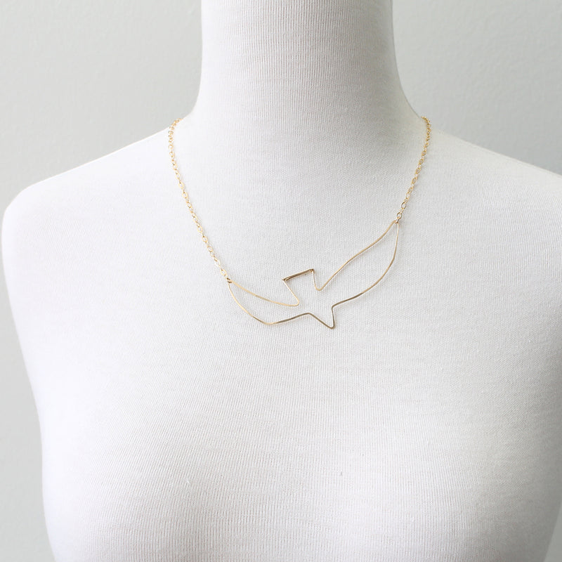 Soaring bird cutout necklace by Peggy Li
