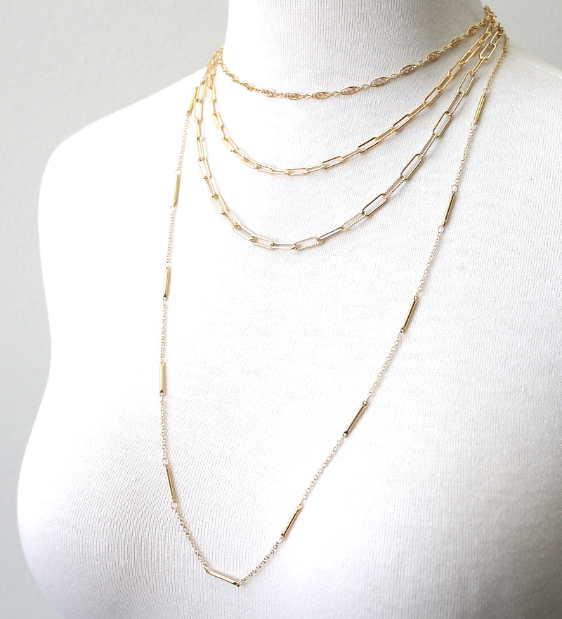Mixed chain necklaces layered