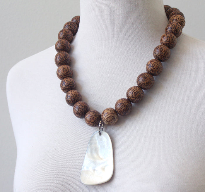 Palm wood and shell necklace
