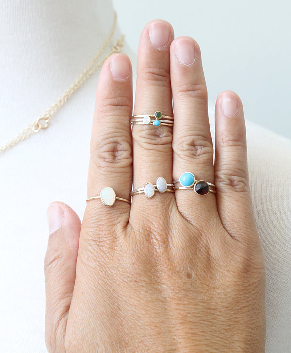 Assorted gemstone rings on hand