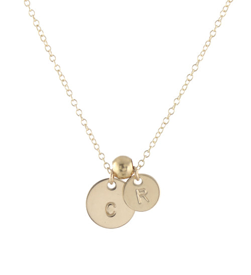 Round gold initial necklace with spacer bead