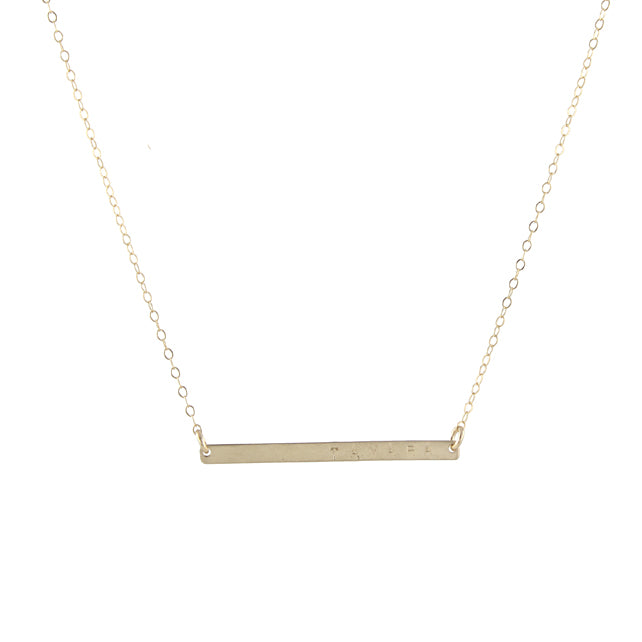 Skinny stamped gold bar necklace