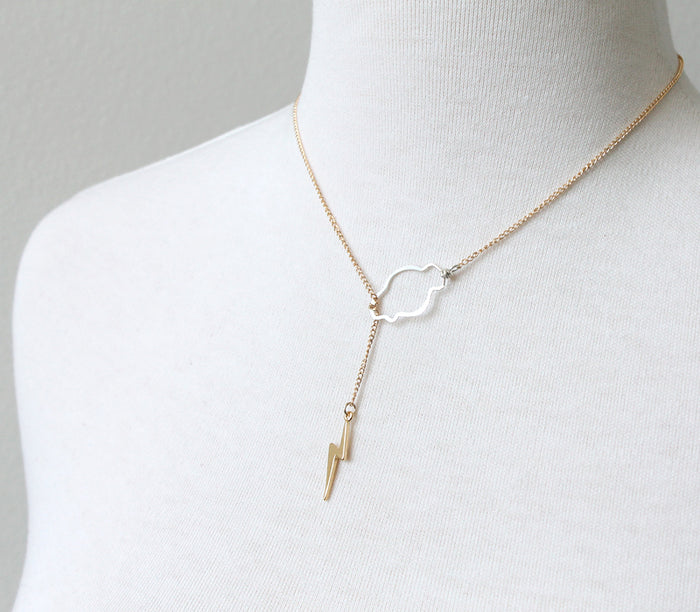 Weather the storm gold bolt lariat