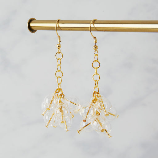 Brass earrings with nine glass beads in a bubble