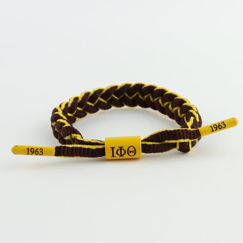 Iota Phi Theta bracelet featuring IΦΘ centerpiece and end caps embossed with 1963, braided paracord, adjustable, gift for Iotas, owtlaws  only at www.thesandz.com