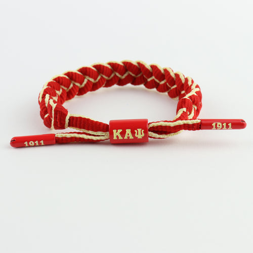 Kappa Alpha Psi bracelet featuring KAΨ centerpiece and end caps embossed with 1911,braided paracord, adjustable, gift for nupes  only at www.thesandz.com
