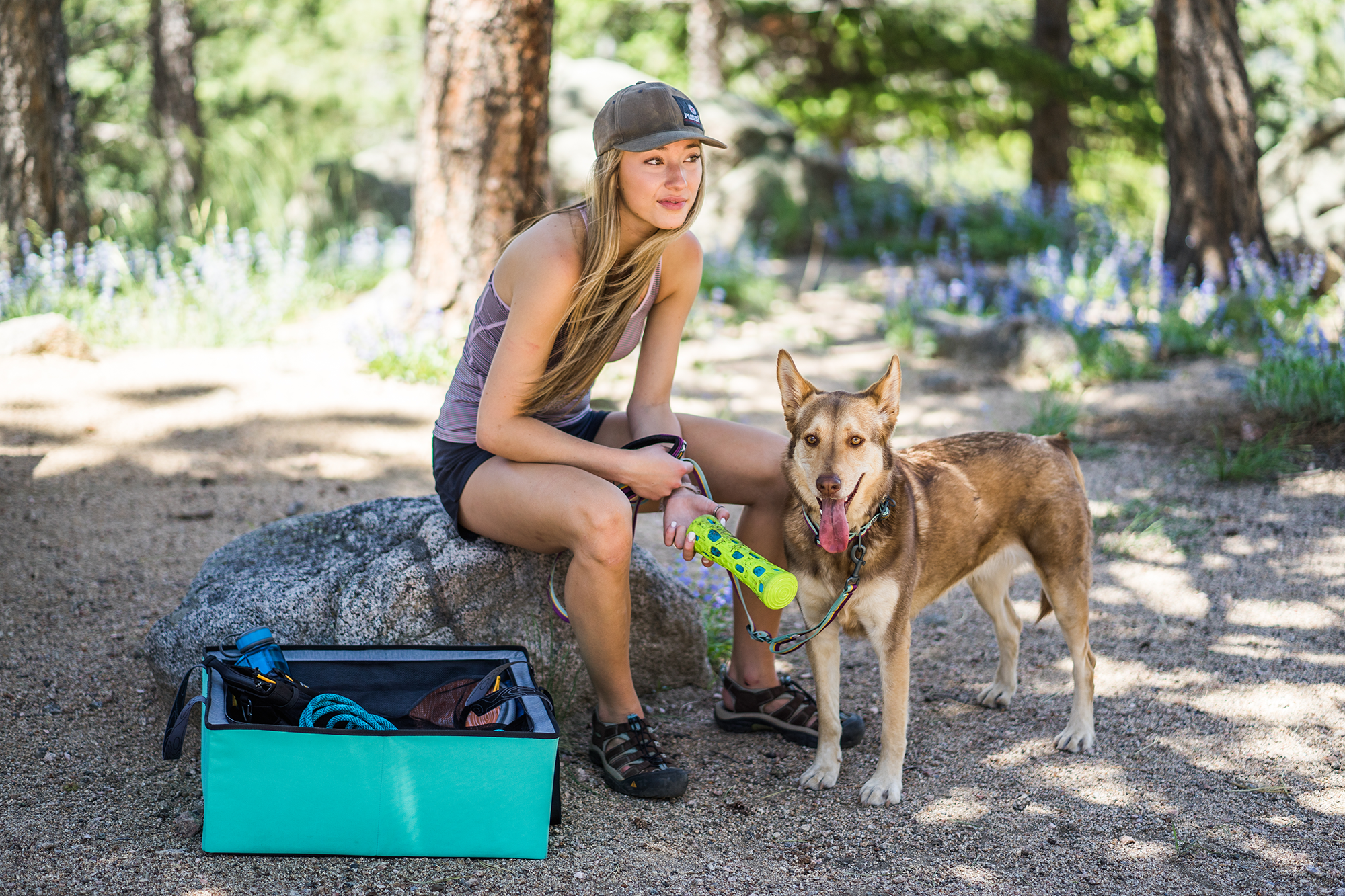 Woman and dog on trail with dog accessories
