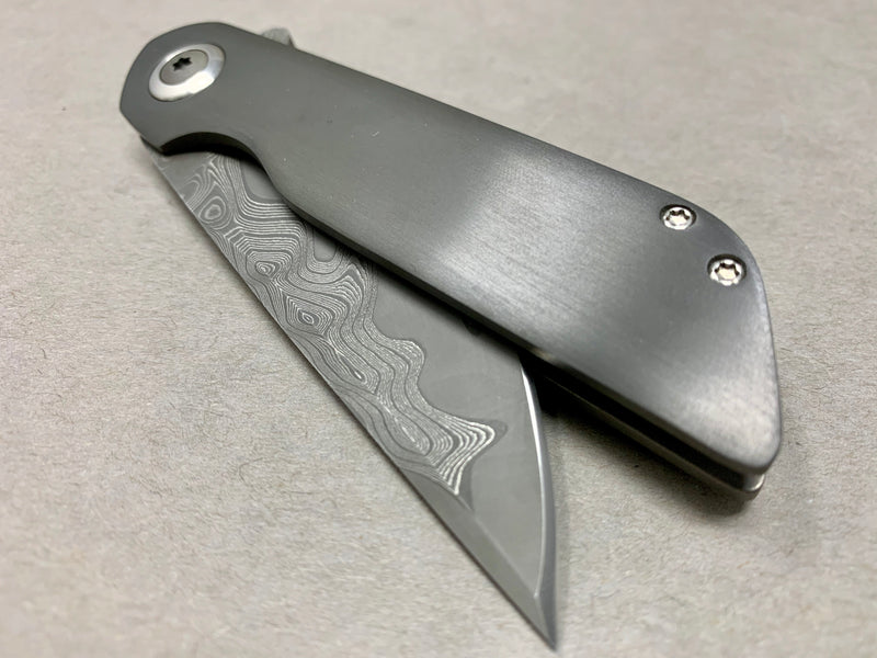 Nova Blades Kwaiken with Zirconium show side & Dark etch Damascus Blade & Clip Tumbled Titanium lockside