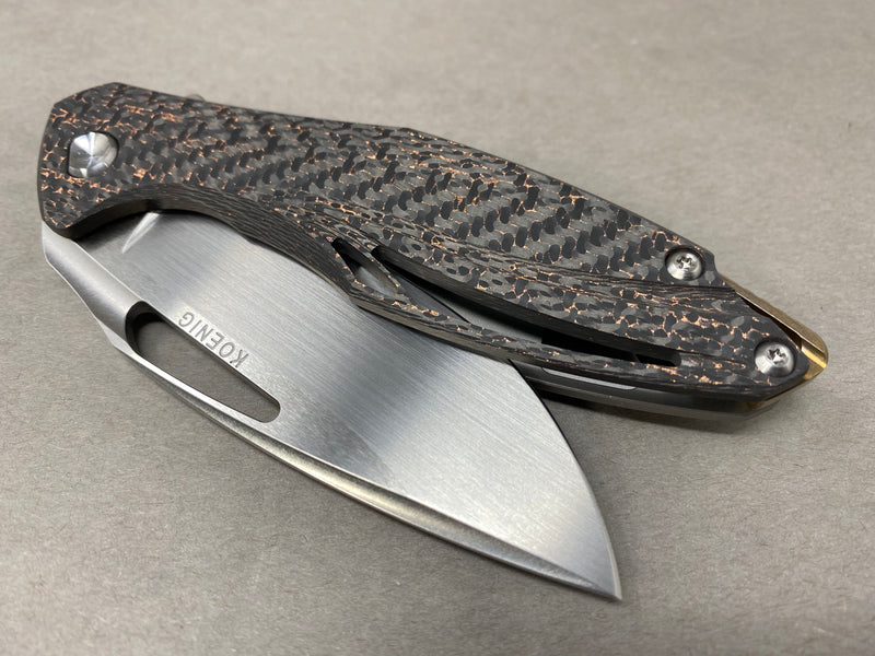 Koenig Arius Style 55 Copper Carbon Weave with Hand Rubbed Blade Satin Hardware and Bronze Ano Clip & Backspacer