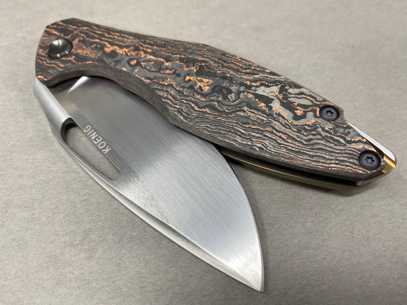 Koeing Arius Copper Dust Marbled Carbon with Hand Rubbed Blade Bronze Ano Lock Side DLC hardware