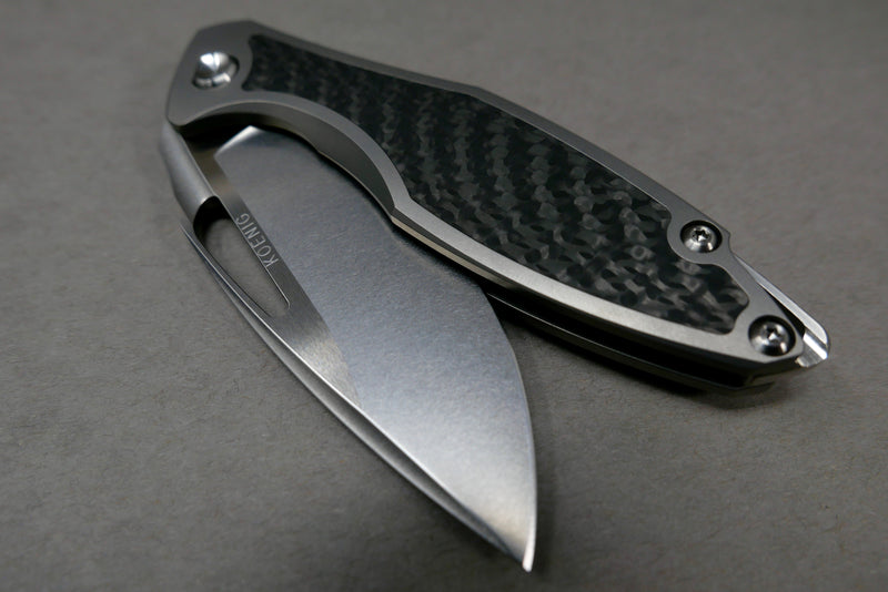Koenig Arius Carbon Weave Inlay Burnished Blade w/ Satin Flats & Polished Hardware
