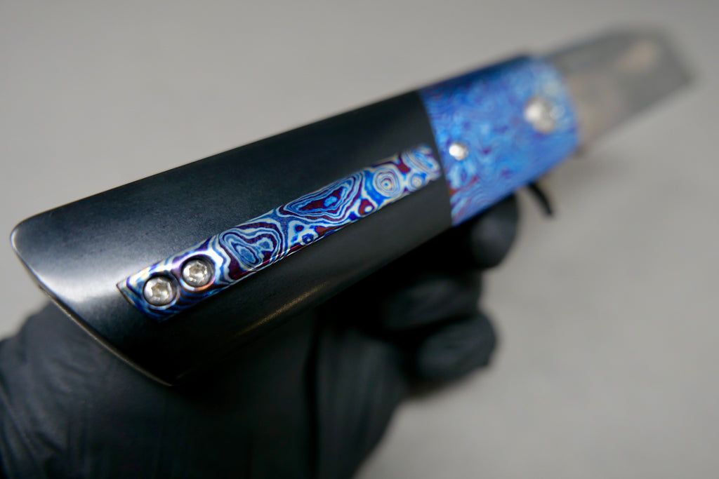 Preowned David Clark Bonto #5 CTS-XHP Blade Timascus Bolsters Black Paper Micarta