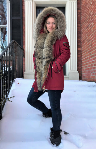 Warm womens winter coat with raccoon trimming