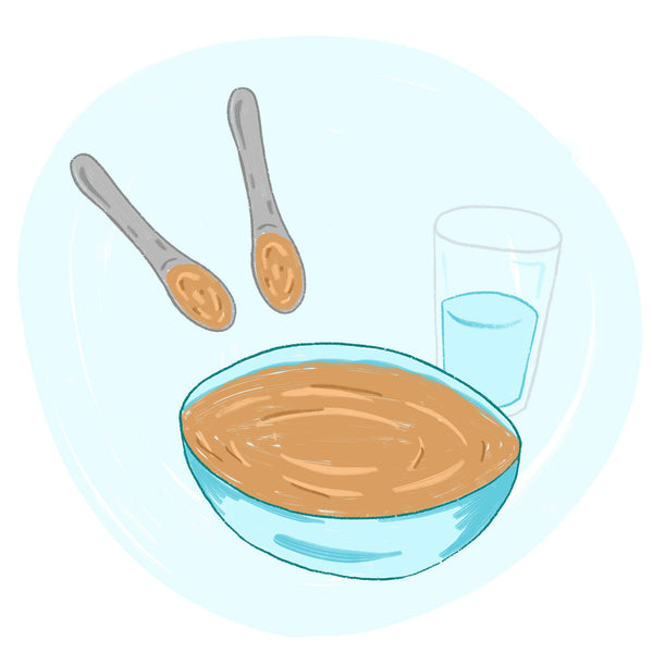 Thinning two teaspoons of peanut butter to mix into baby food