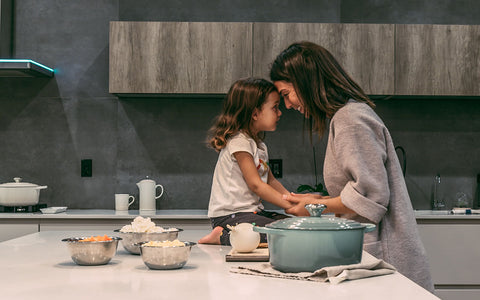 mom and daughter on kitchen counter about to cook