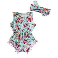 SUZY: Floral Romper with Pink Tassels