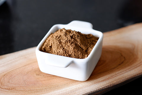 Organic hojicha powder in a white, ceramic bowl