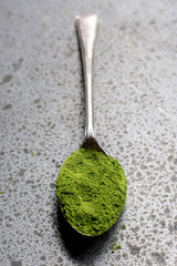 A spoonful of powdered green matcha