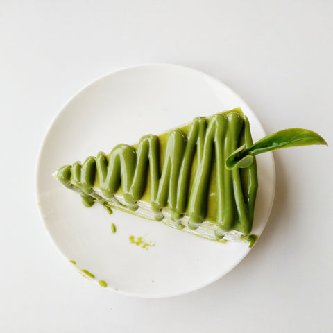 Green, Japanese green tea matcha cheesecake on white plate