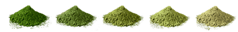 Piles of Japanese green tea matcha powder lined up to show different matcha qualities.
