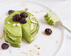 Green matcha pancakes sit on a plate as an example of emerging food industry trends of 2020