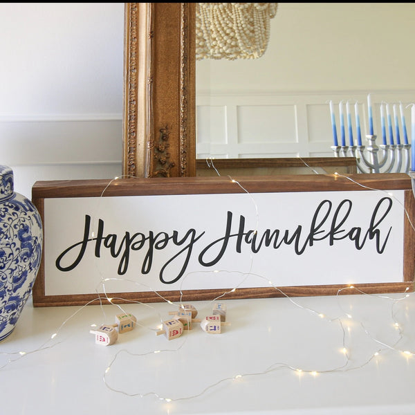 Hanukkah tablescape featuring Star of David tealights, embroidered Hanukkah runner & Happy Hanukkah framed sign- peacelovelightshop.com, styling and photgraphy by stefanasilber.com