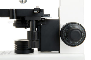 Side view of the Celestron Labs CB2000C Compound Microscope (SKU: 44132) showing the stage, condenser, focusing knob, and light source.