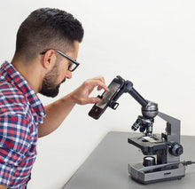 Man using Carson MS-100SP Smartphone Microscope