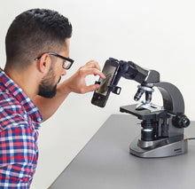 Man using the Carson MS-160SP Smartphone Microscope