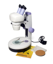 Levenhuk 5ST Microscope (SKU: 35321) with instruction manual, power supply, and alternative stage plate.