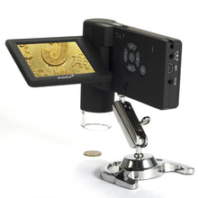 Levenhuk DTX 500 Mobi Digital Microscope (SKU: 61023) with coin on LCD display.