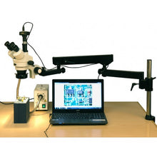 AmScope 3.5X-180X Fiber Ring Articulating Zoom Stereo Microscope (SKU: SM-8TZZ-FOR-10M) connected to a laptop displaying an image of a circuit board.
