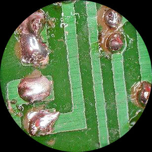 Green circuit under a stereo microscope.