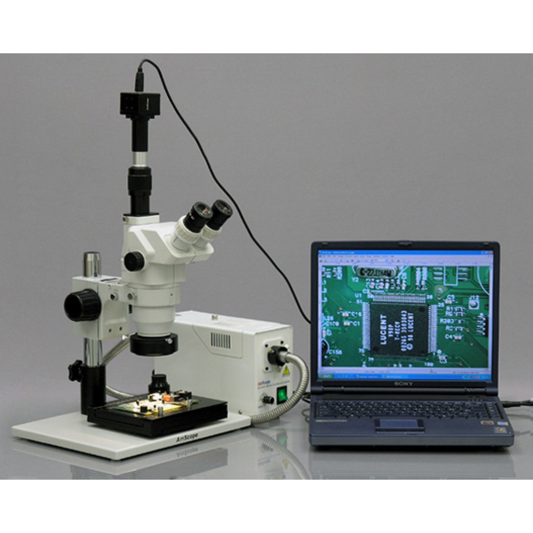 Fully setup AmScope 3.35X-90X Industrial Inspection Microscope (SKU: ZM-1TZ-FOR-GT-5M) transmitting an image of a circuit to a laptop computer.