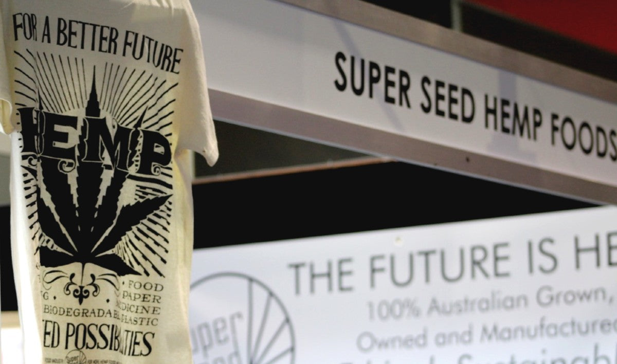 Hemp shirt hanging in front of Super Seed Hemp Foods sign