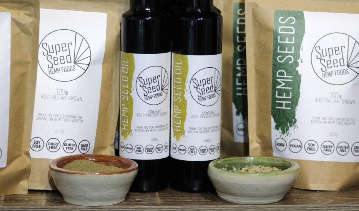 Hemp seed oil bottles next to hemp products