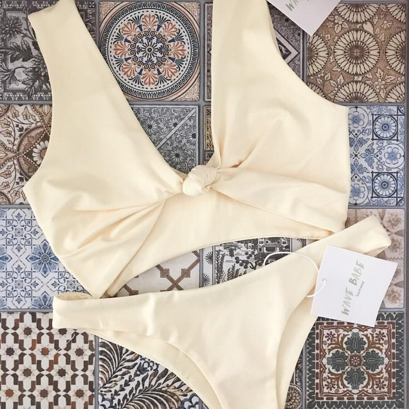 Havana Knot Bikini Top | Soft Yellow Hibiscus - Wave Babe Swimwear - Best swimwear brands. Hawaii. California. High Cut Bottoms. Gorgeous SS19 Full Coverage Sexy Swimsuit. Pretty New Flatlay