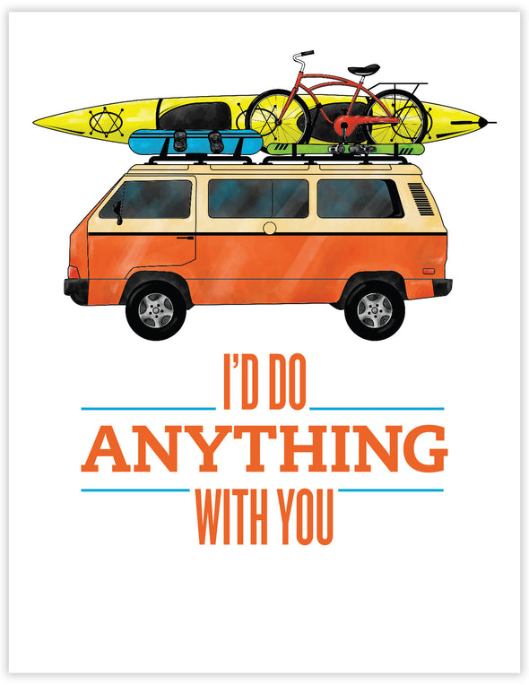 orange and cream volkswagen camper van with sea kayak, snowboard, skis and a bike on the roof.