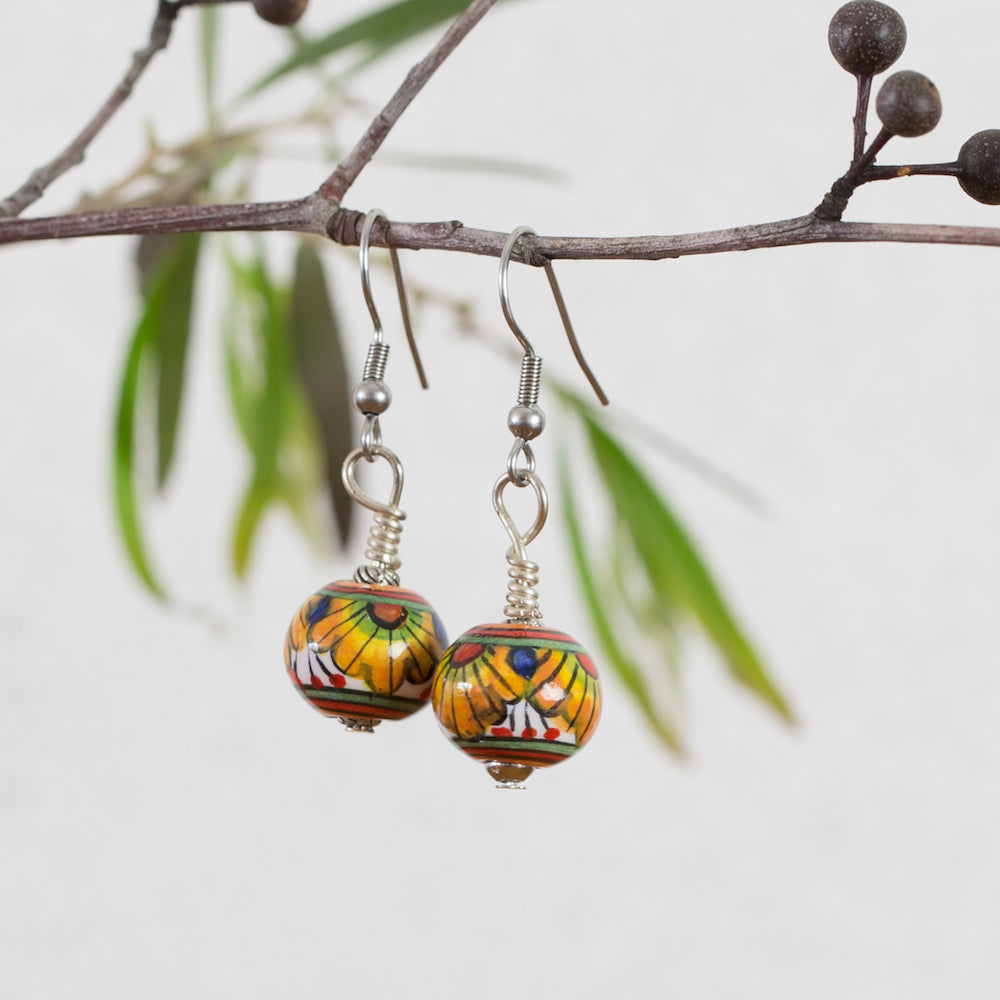 Hand painted ceramic earrings - yellow, red, blue & green - round - surgical steel