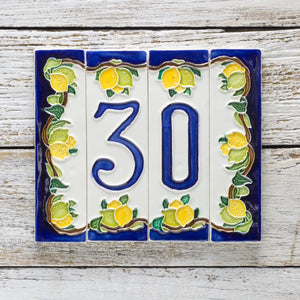 Italian ceramic number tile featuring lemons and blue contrast on a white background.