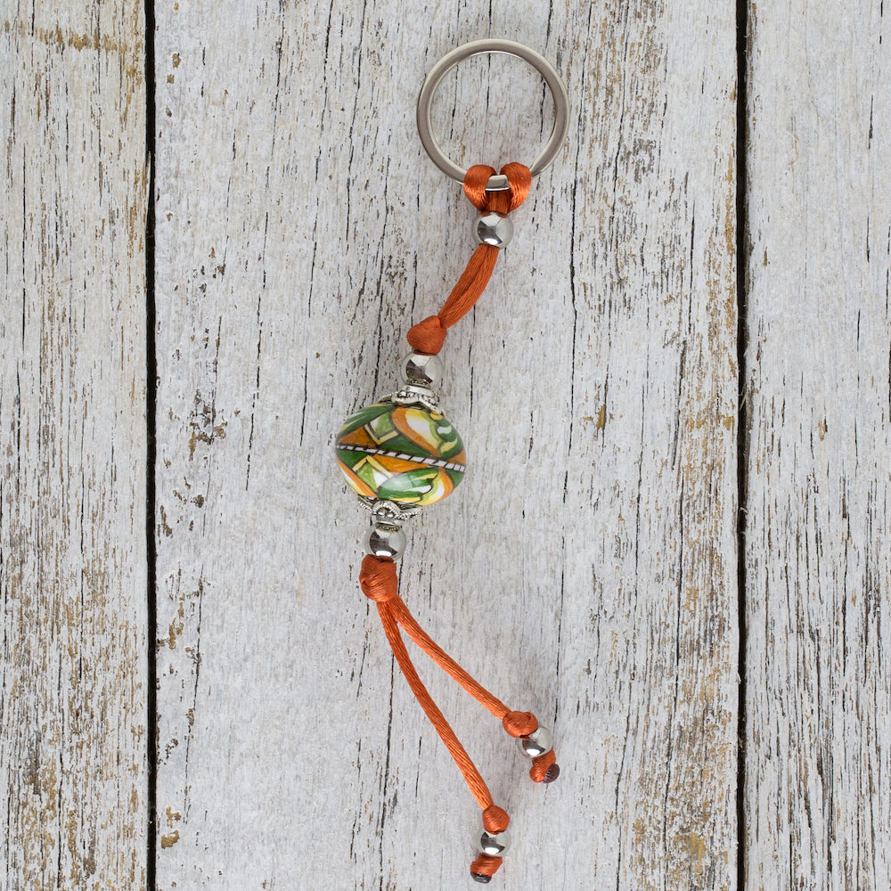 Keyring with hand painted ceramic ball - green, orange & yellow
