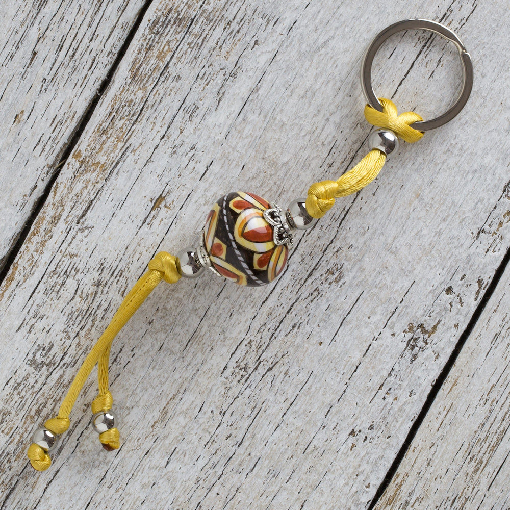 Keyring with hand painted ceramic ball - terracotta, black & yellow