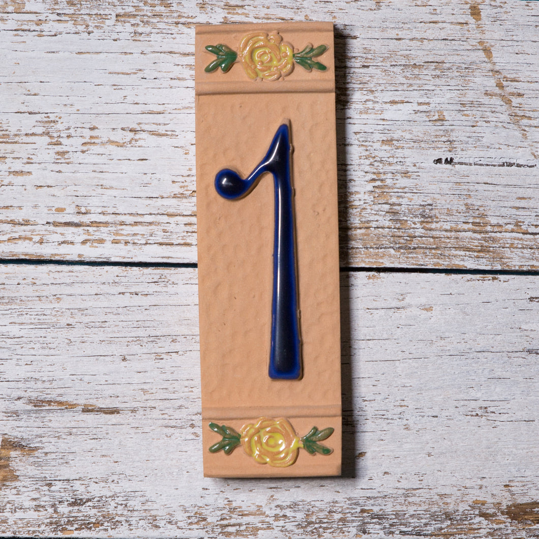 Ceramic number tile - terracotta - blue number with yellow flowers