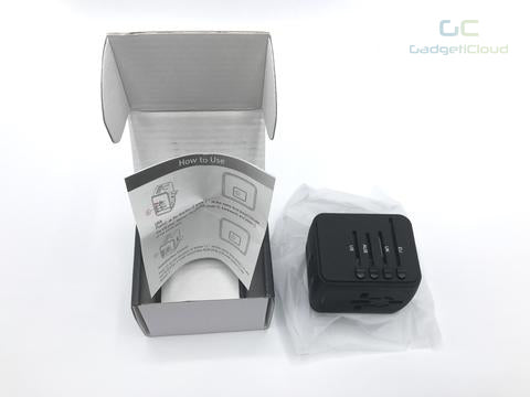 Universal travel adapter with USB port - GadgetiCloud open package eu us uk au plugs