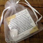 Clear Quartz Tumbled Stone in bag with description card